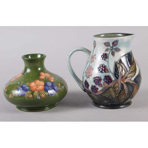 30 - A Moorcroft Sally Tuffin design floral squat vase, 4