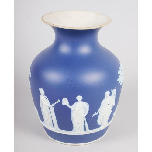 41 - A 19th century Wedgwood blue jasperware vase with classical figure decoration, 6 3/4