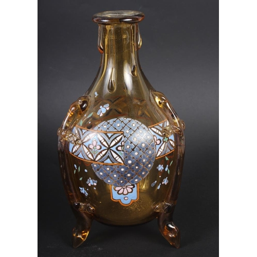 48 - An amber glass and enamel decorated decanter, on three supports COLLECT...