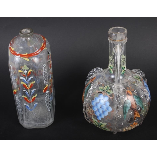 49 - A 19th century glass bottle with carrying handles and enamelled bird and fruit decoration, 6 1/4