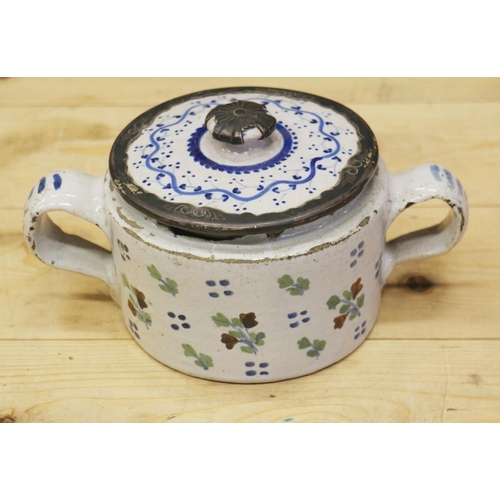 6 - An 18th century Delft ware two handled posset pot and associated cover with white metal mounts, 8 1/...