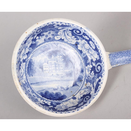 15 - A 19th century blue and white ladle, decorated house in a landscape, 13