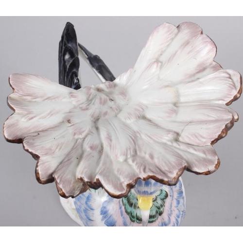 12 - A Continental porcelain model of an exotic bird, 9 1/2