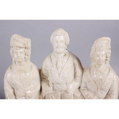 13 - A Staffordshire figure group,