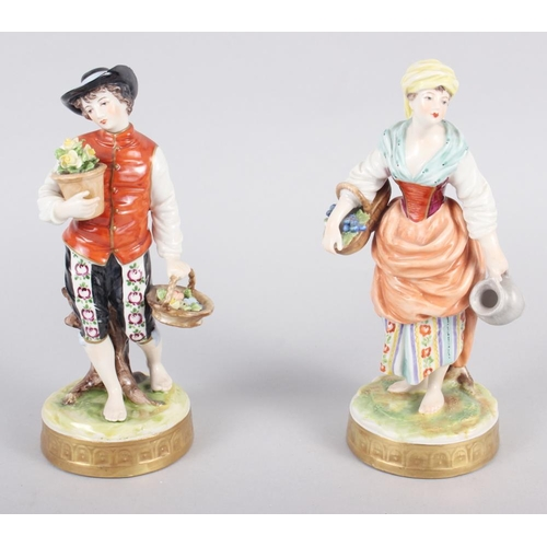 22 - A pair of Continental figures, flower sellers, 7 1/2