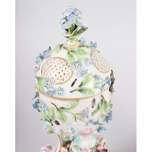 24 - A pair of pot pourri jars with hinged covers and insect and relief floral decoration...