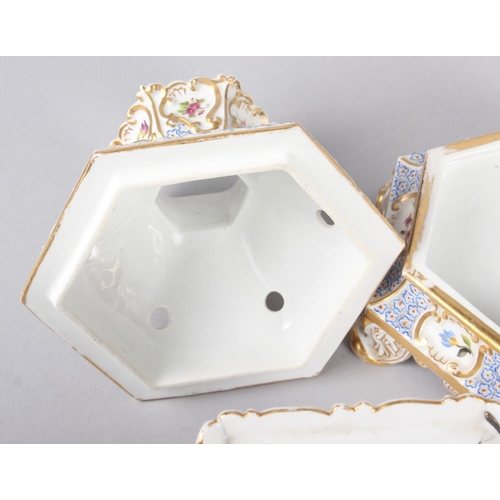 27 - A pair of early 19th century Fontainebleau hexagonal two-handle pot pourri vases, covers and stands ...