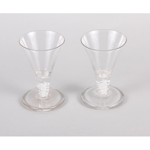 34 - A pair of cotton twist stemmed firing glasses, 4 1/2