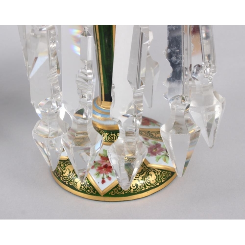 35 - A pair of green glass lustres with gilt and floral panel decoration, hung cut glass spear point drop...