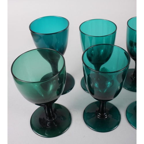 36 - A set of six 19th century green glass conical wines, an early 19th century green glass rum decanter ...