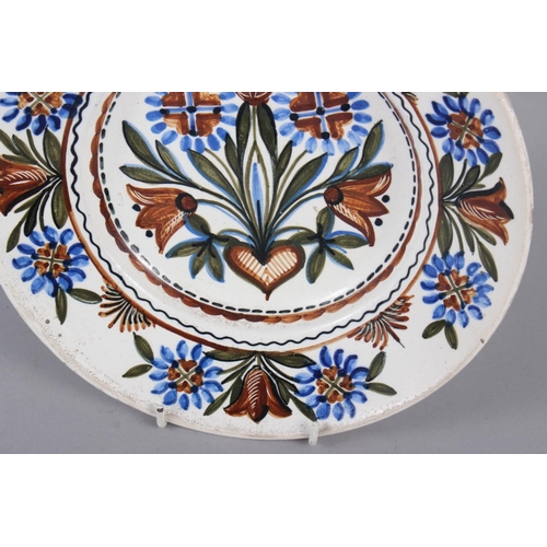 4 - A Thun type wall plate with floral decoration, 9 3/4