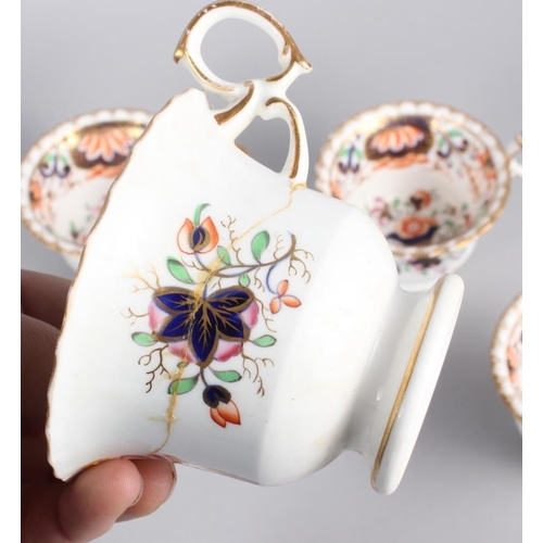 44 - A 19th century English porcelain part tea service for six, in the Imari palette with gilt highlights...