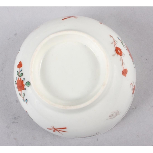 45 - An 18th century English porcelain tea bowl, decorated insects and flowers, a Ridgeway jug with flora...