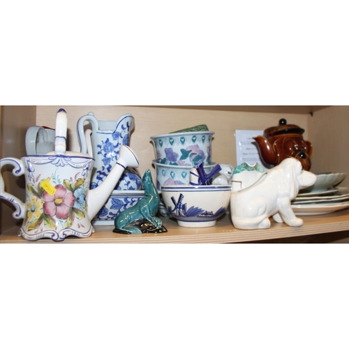 51 - A blue and white toilet jug and basin, a pair of planters, on stands, a floral decorated watering ca...