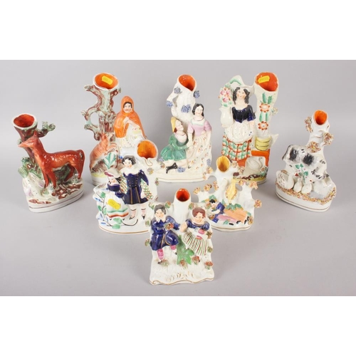 54 - Eight Staffordshire figure spill vases, including Little Red Riding Hood, 10