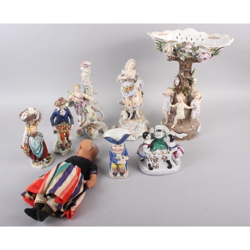55 - A Continental centrepiece with dancing children and relief flower decoration, 14