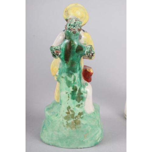 58 - A Derby figure of a woman, 10