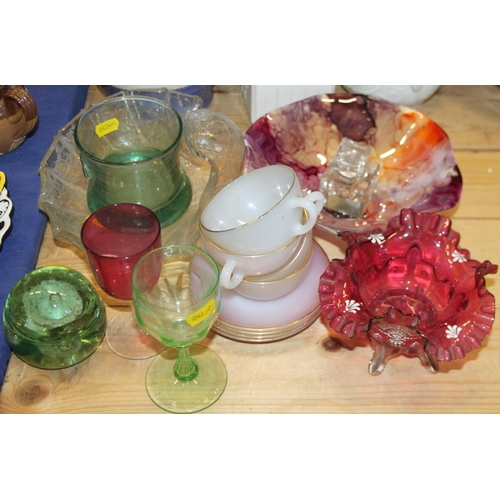 60 - A Victorian cranberry glass table centre, an iridescent shell-shaped table centre, a paperweight, a ...