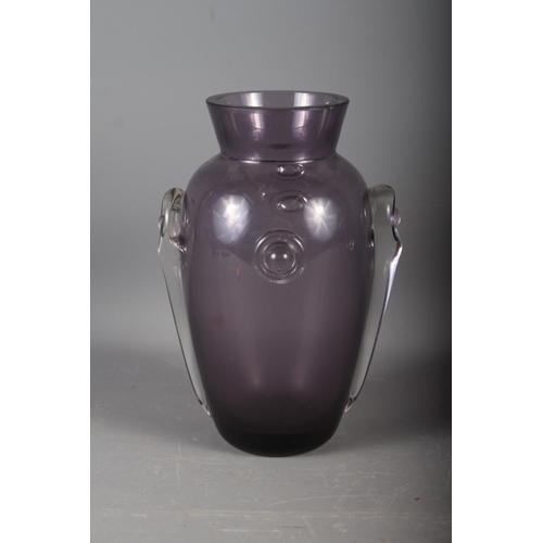 23 - An early 20th century amethyst glass vase with applied decoration, 10