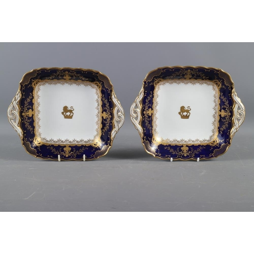 4 - A pair of Coalport porcelain dishes with gilt armorial decoration, 9 1/2