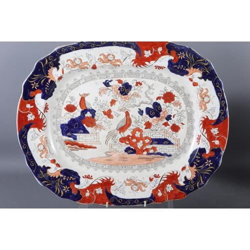 55 - An Imari style platter, a Losolware octagonal dish, three Imari style plates, a Royal Crown Derby Im...
