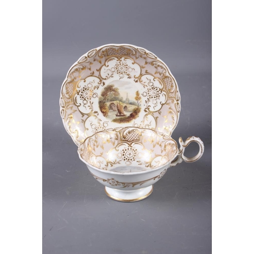 11 - A 19th century Derby cabinet cup and saucer with landscape panels and gilt scroll work borders (craz...