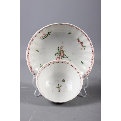 9 - A Newhall (Factory X) cream jug (hair crack) and a pair of similar fluted tea bowls and saucers (fri...