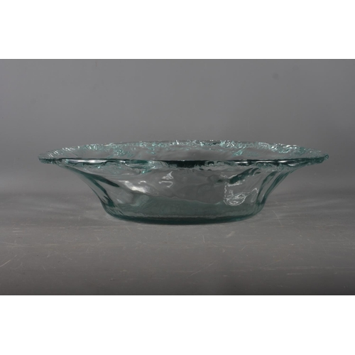 24 - A clear glass oval bowl with waved edge, 20