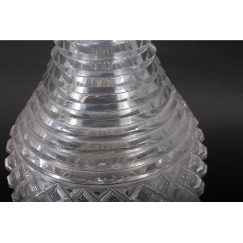 25 - A pair of Georgian cut glass decanters with ribbed necks, 10 1/4