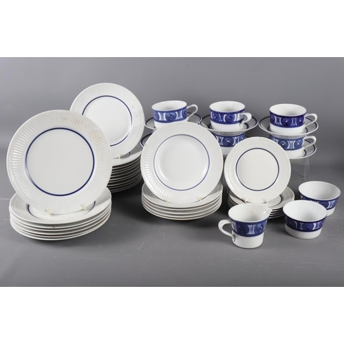 27 - A Royal Worcester blue and white porcelain part tea service and a quantity of Torquay ware