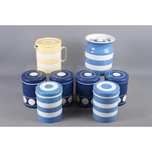44 - Seven Cornishware blue and white storage jars, and a yellow and white Cornishware jug and cover, 6