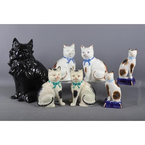 45 - A black glazed model of a cat, 13