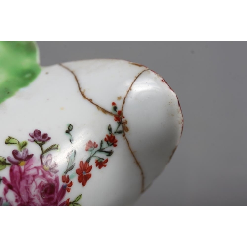 7 - A Longton Hall cream jug with openwork twist handle and leaf relief decoration and enamel floral spr...