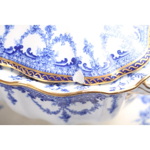 35 - A Royal Crown Derby blue and white part dinner service, decorated floral swags with gilt borders, ei...
