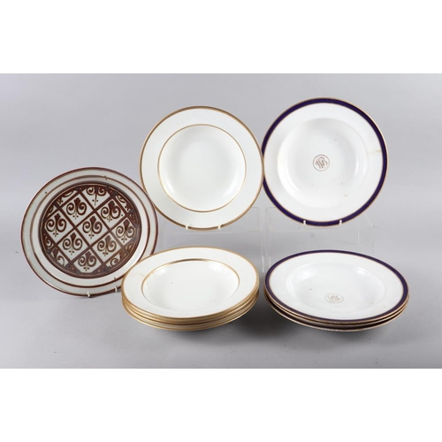 59 - Two Quimper figure decorated plates, four blue and white tin glazed plates, a number of Doulton bone...
