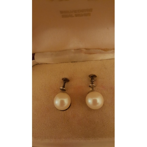 18 - A pair of Rosita pearl and silver clip ear rings, boxed...