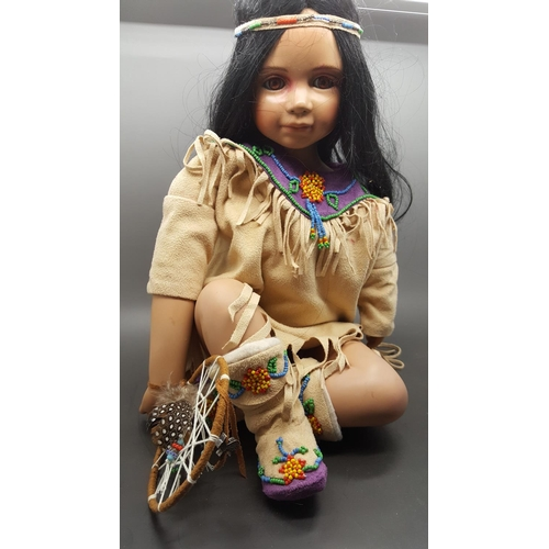 21 - A native American porcelain doll with flexible limbs. Rare...