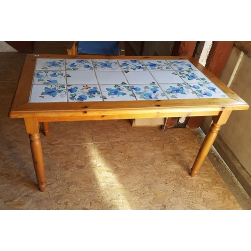 29 - A modern pine table decorated with tiles. 139x77cm....