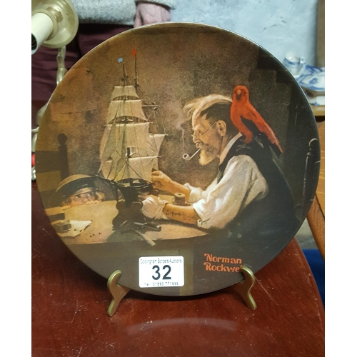 32 - A Norman Rockwell commemorative plate on a stand...