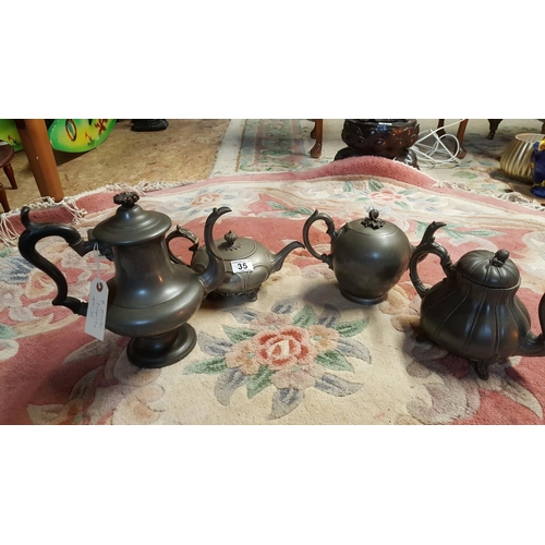 35 - A collection of four pewter teapots, two with the mark of James Dixon, Sheffield, and one with that ...