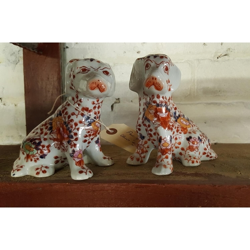 39 - A pair of Chinese dogs in the imari palette...