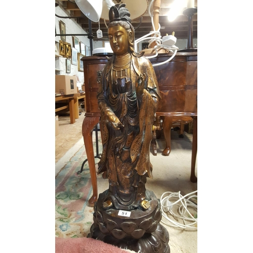 51 - A large bronzed Far Eastern figure of guanyin, the Goddess of Mercy. Probably Chinese 20th century....