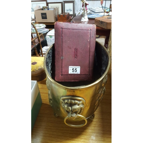 55 - A decorative brass container on ball & claw feet and a set of boxed precision engineering tools, ear...