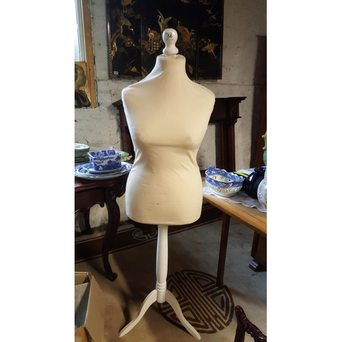 56 - An adjustable tailor's dummy on stand...