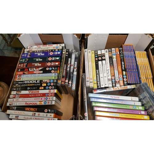 57 - Two boxes of DVDs (2)...