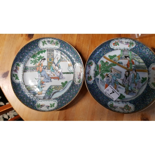 7 - Two famille verte Chinese plates well enamelled over glaze and painted with figures in a garden. Dia...