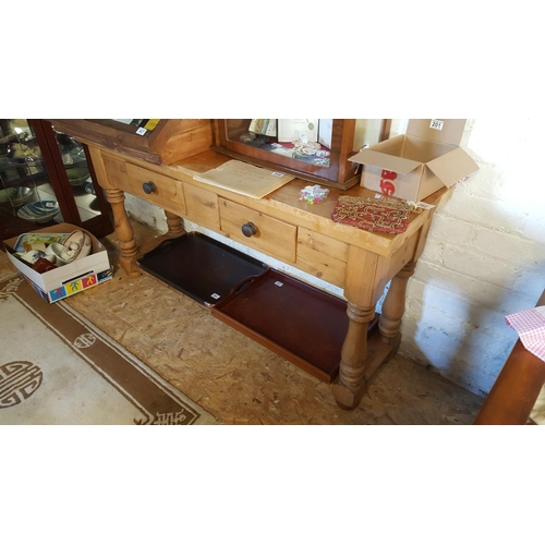 48 - A large late 19th or early 20th century pine table with two drawers, a working surface and a base pl...