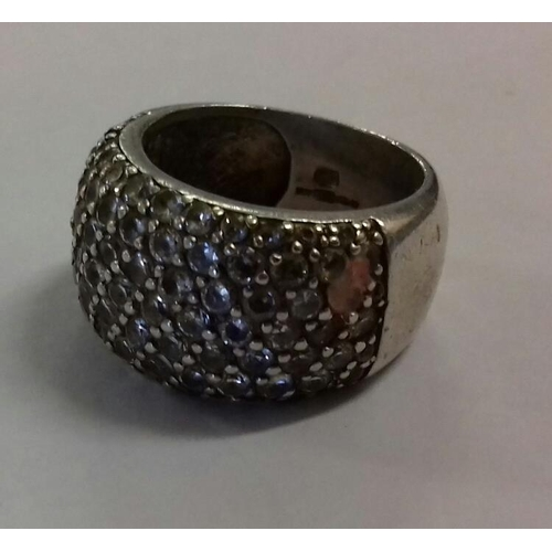 569 - Tarnished Silver with cubic zirconia dress ring, few stones missing, size M...