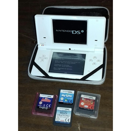 535 - Nintendo DSi with 4 games being puzzlemaster, brain training, My Sims and Tinkerbell Lost Treasure...