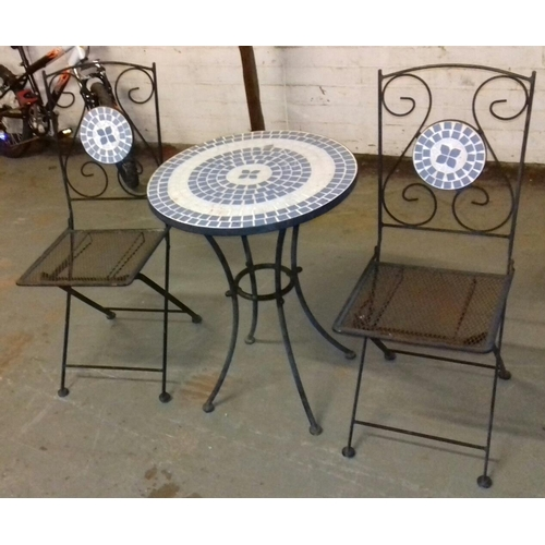 393 - Metal and tile topped garden table and 2 x folding chairs...